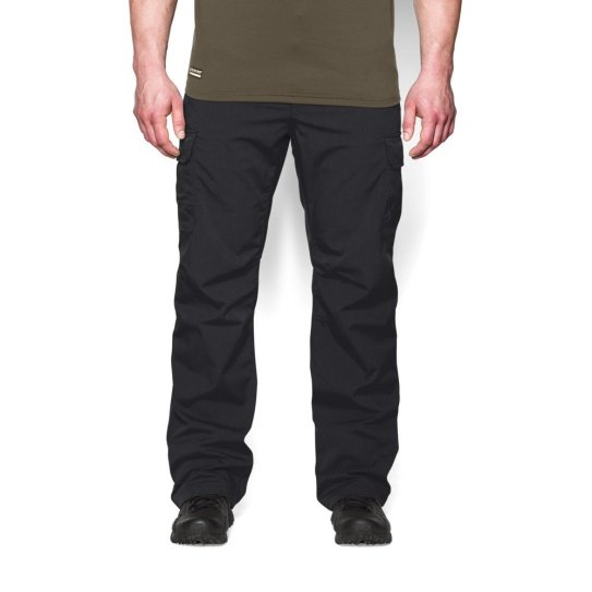 Image of man wearing black Under Armour Tactical Patrol Pants. This is item number 9 in the list of 10 Best Unique Survival Gifts for Preppers.